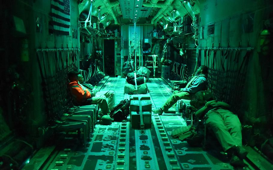 Passengers try to get some sleep on a late night C-130J flight from Kandahar Air Field to Bagram Air Field, Afghanistan, May 5, 2017.