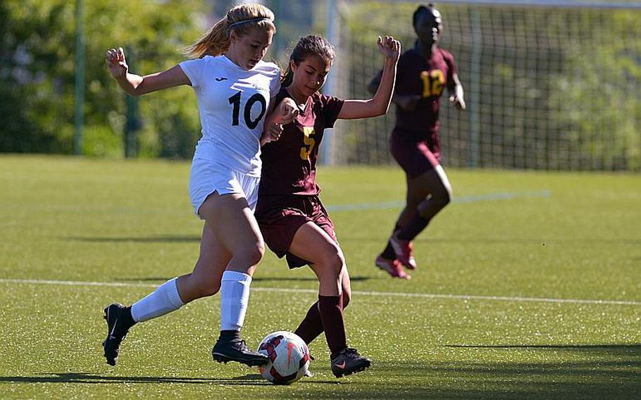 Naples' Kylie Harrison, left, and Vilseck's Angelica Scroggs battle for a ball in Division I action at the DODEA-Europe soccer championships in Reichenbach, Germany. Naples won 7-0.