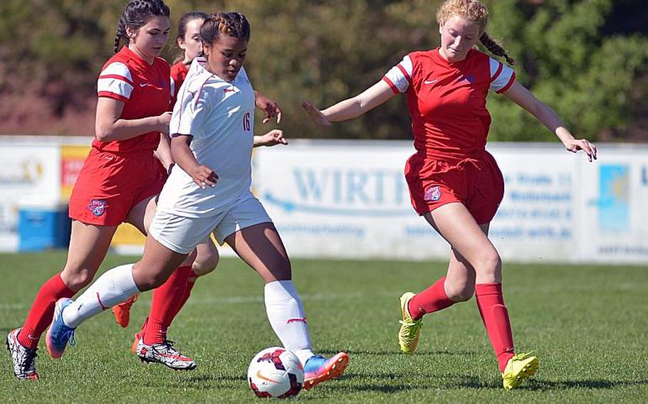 Kaiserslautern's Paola Zorilla scores a goal as ISB's Hannah Hauch tries to block her in a Division I game at the DODEA-Europe soccer championships in Reichenbach, Germany. Kaiserslautern won 2-0.