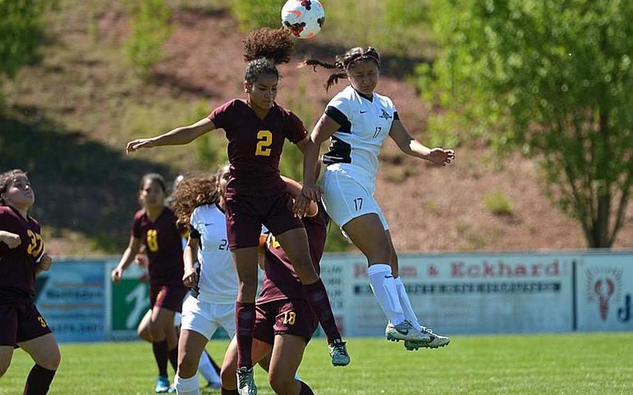 Vilseck's Aliyah Cottrell, left, defends against Ramstein's Faith East in Division I action at the DODEA-Europe soccer championships in Reichenbach, Germany. Ramstein won 3-1.