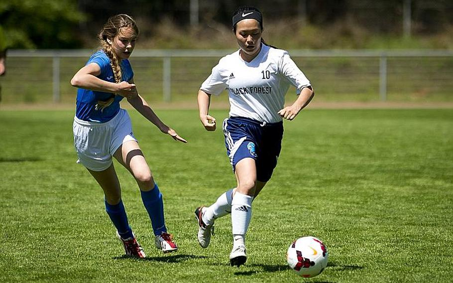 Black Forest Academy's Erin Cho, right, dribbles past Marymount's Matilde Di Tommaso during the DODEA-Europe soccer tournament in Landstuhl, Germany, on Wednesday, May 17, 2017. BFA won the Division II match 1-0.  MICHAEL B. KELLER/STARS AND STRIPES