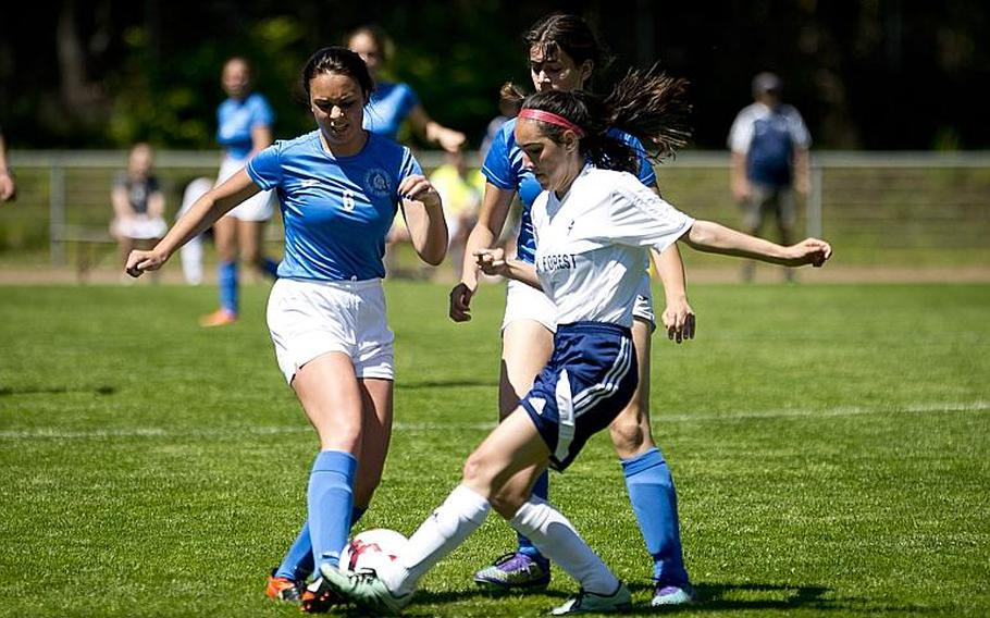 Marymount's Emanuela Scalia, left, and Black Forest Academy's Natalie Wagner battle for the ball as Marymount's Djamilia Savcenco moves in to help during the DODEA-Europe soccer tournament in Landstuhl, Germany, on Wednesday, May 17, 2017. Marymount lost the Division II match 1-0.  MICHAEL B. KELLER/STARS AND STRIPES