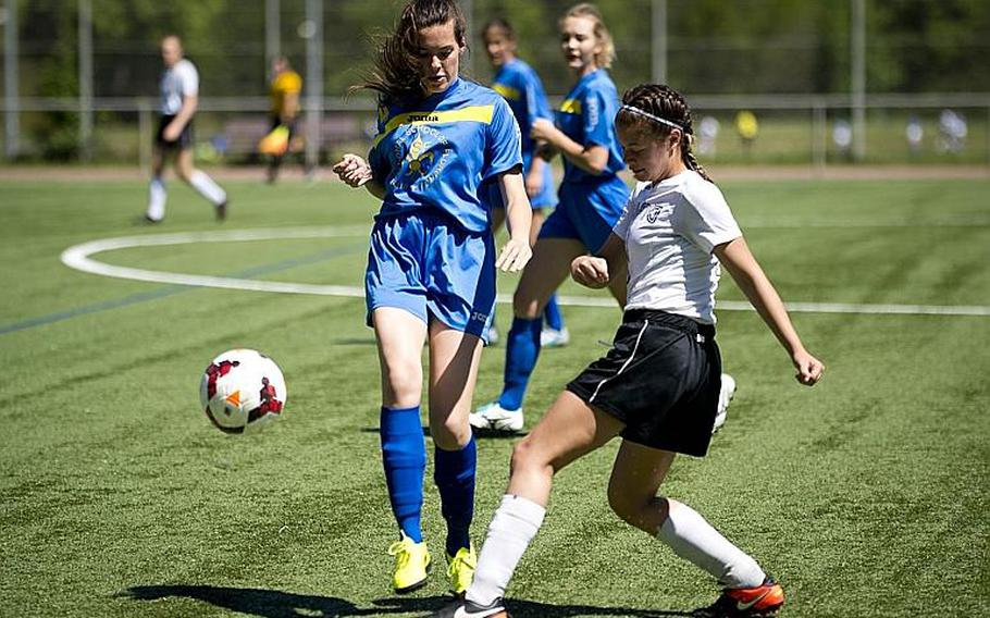Aviano's Alyssa Mendez, right, passes the ball past Florence's Sophie De Godoy Van Wij during the DODEA-Europe soccer tournament in Landstuhl, Germany, on Wednesday, May 17, 2017. Aviano won the Division II match 4-0.  MICHAEL B. KELLER/STARS AND STRIPES