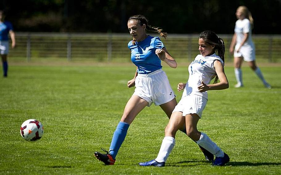Rota's Nicolle Perez, right, passes the ball past Marymount's Veronika Ilencikova during the DODEA-Europe soccer tournament in Landstuhl, Germany, on Wednesday, May 17, 2017. Rota won the Division II match 1-0.  MICHAEL B. KELLER/STARS AND STRIPES