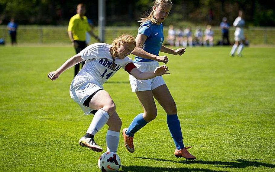 Rota's Emma Hook, left, tries to dribble past Marymount's Arna Mathiesen during the DODEA-Europe soccer tournament in Landstuhl, Germany, on Wednesday, May 17, 2017. Marymount lost the Division II match 1-0.  MICHAEL B. KELLER/STARS AND STRIPES