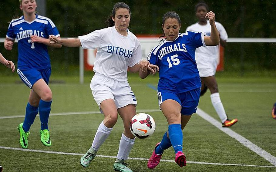 Bitburg's Emma Passig, left, and Rota's Jasmine Garrison race for the ball during the DODEA-Europe Division II semifinals in Reichenbach, Germany, on Friday, May 19, 2017. Bitburg won the match 3-1 after a shootout.  MICHAEL B. KELLER/STARS AND STRIPES