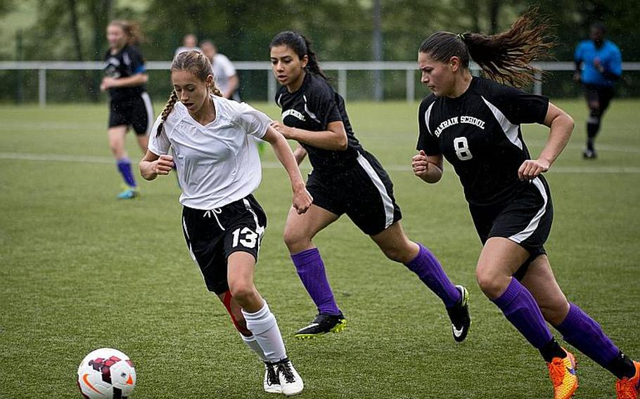 AFNORTH's Kyla Kolosky dribbles the ball ahead of Bahrain's Christina Lopez, right, and Asmaa Hussein during the DODEA-Europe Division II semifinals in Reichenbach, Germany, on Friday, May 19, 2017. AFNORTH won the match 2-1 in double overtime.  MICHAEL B. KELLER/STARS AND STRIPES