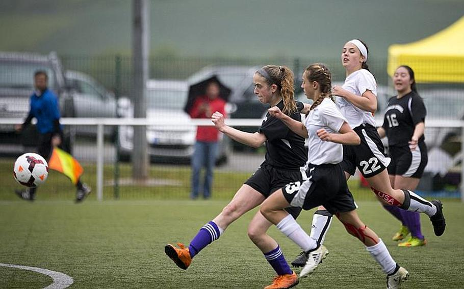 Bahrain's Zoie Howes shoots the ball ahead of AFNORTH's Carolyn Mote, right, and Kyla Kolosky during the DODEA-Europe Division II semifinals in Reichenbach, Germany, on Friday, May 19, 2017. Bahrain lost the match 2-1 in double overtime.  MICHAEL B. KELLER/STARS AND STRIPES