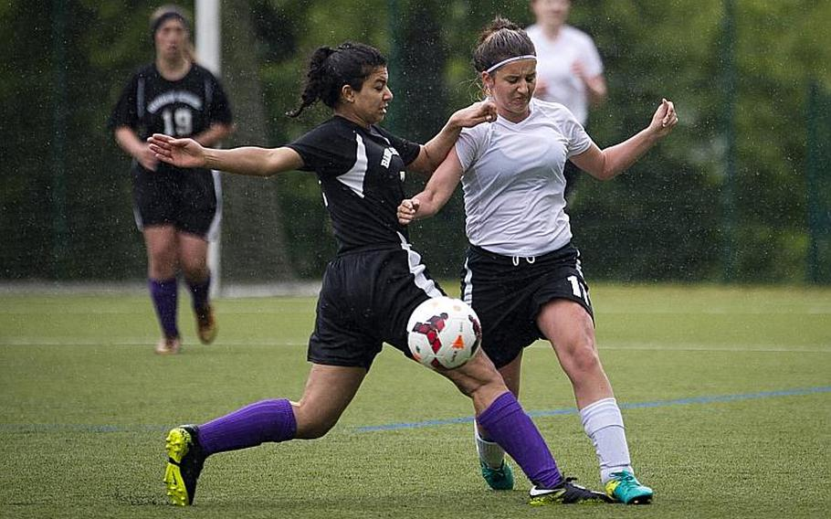 AFNORTH's Kayla Lambiase, right, and Bahrain's Asmaa Hussein battle for the ball during the DODEA-Europe Division II semifinals in Reichenbach, Germany, on Friday, May 19, 2017. AFNORTH won the match 2-1 in double overtime.  MICHAEL B. KELLER/STARS AND STRIPES