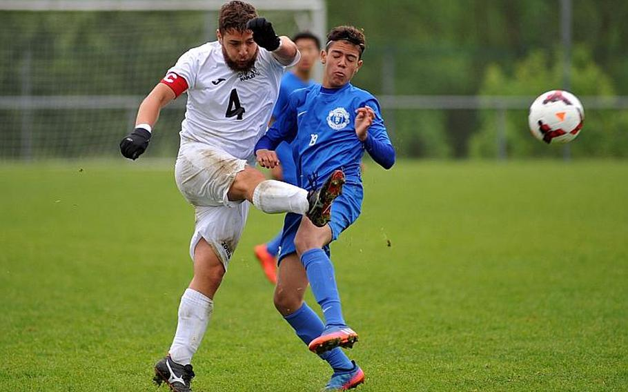 Naples' Matteo Pugliese gets off a shot against Ramstein's Diego Colon in a Division I semifinal at the DODEA-Europe soccer championships in Reichenbach, Germany. Ramstein beat Naples 1-0 in overtime to advance to Saturday's final.
