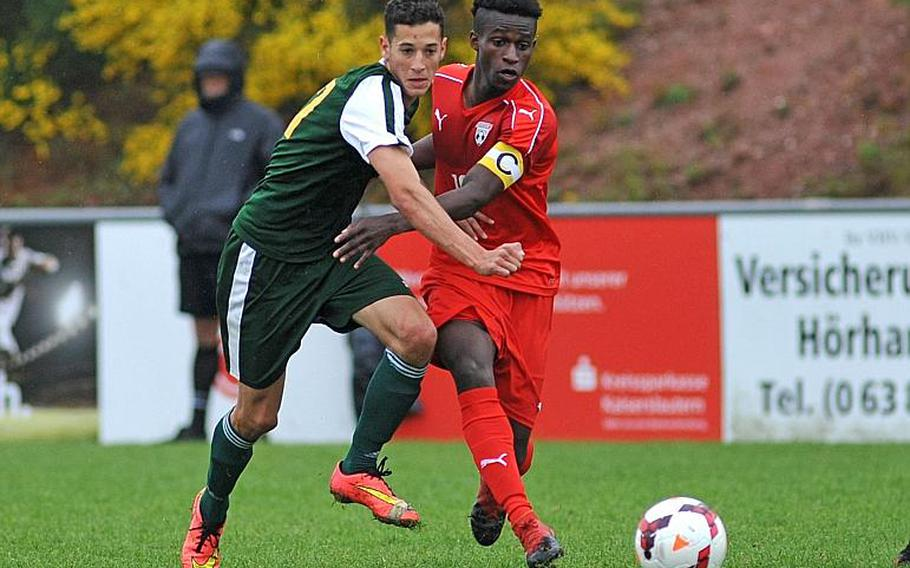 SHAPE's Alvaro Segura and Kaiserslautern's Alexander Dexter battle for the ball in a Division I semifinal at the DODEA-Europe soccer finals in Reichenbach, Germany. Kaiserslautern won 5-0 to advance to Saturday's finals.