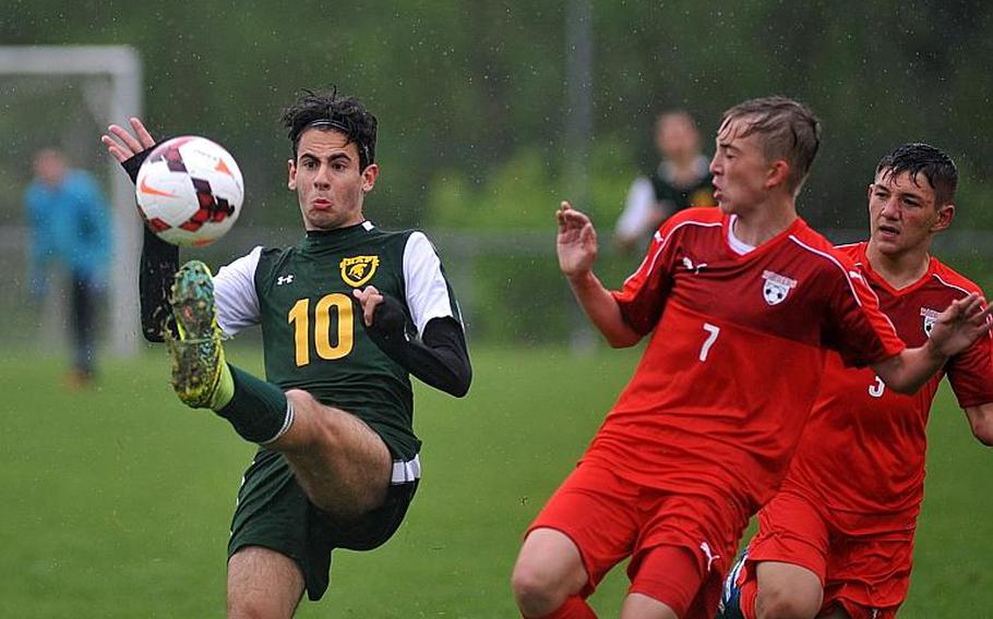 SHAPE's Riccardo Pellegrino clears the ball in front of Kaiserslautern's Philipp Rimmler and Conner Mackie in a Division I semifinal at the DODEA-Europe soccer finals in Reichenbach, Germany. Kaiserslautern won 5-0 to advance to Saturday's finals.