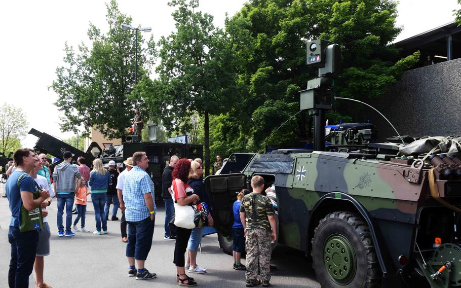 Americans and Germans look at the German army's Fennek Light Armored Reconnaissance Vehicle at the Day of the German Army in Weiden, Germany, Saturday, June 10, 2017.