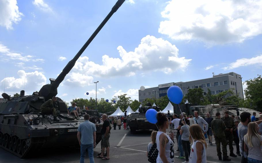 Americans and Germans learn about German army artillery and tanks at the Day of the German Army, in Weiden, Germany, Saturday, June 10, 2017.
