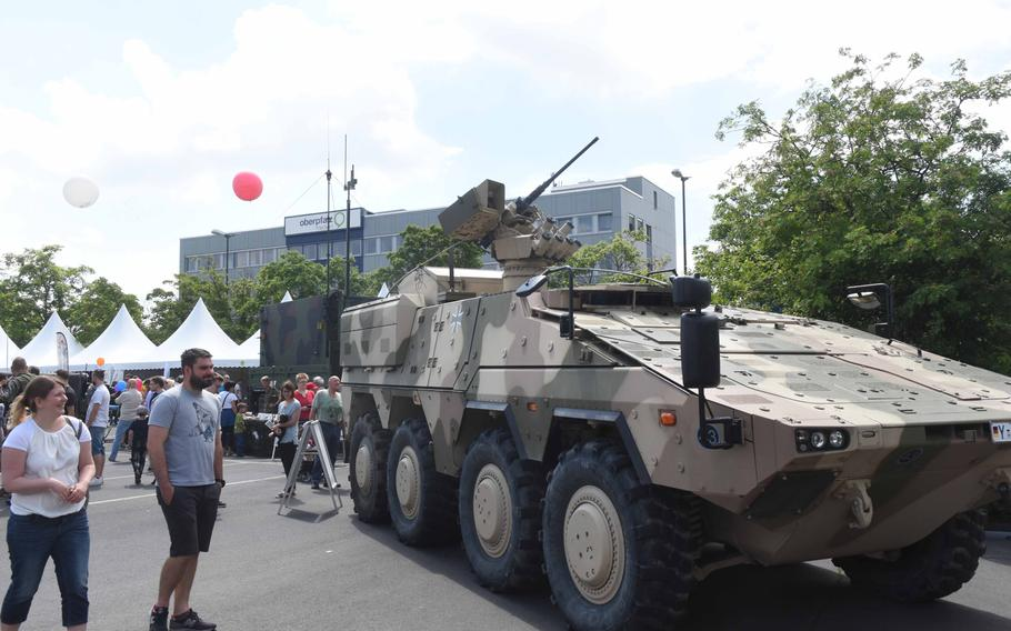 American and German families observe the German army's Boxer Armored Fighting Vehicle at the Day of the German Army, in Weiden, Germany, Saturday, June 10, 2017.