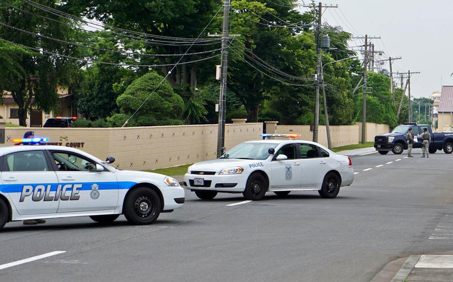 Security forces cordon off an area where construction workers discovered unexploded ordnance at Yokota Air Base, Japan, Monday, June 26, 2017.