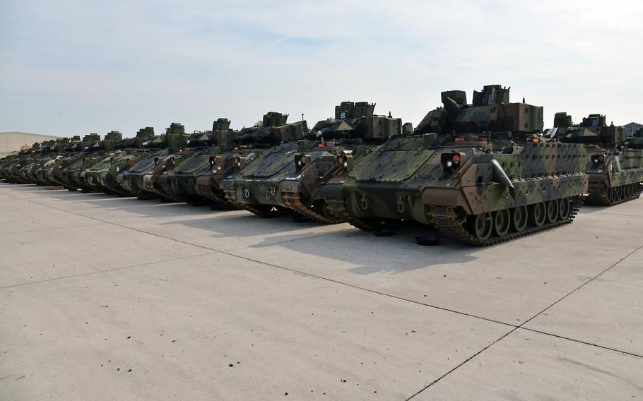Rows of Bradley Fighting Vehicles sit in orderly lines at Coleman Barracks in Mannheim, Germany. The Bradleys and thousands of other pieces of equipment ranging from M-149 Water Buffalo trailers to M1 Abrams tanks that are stored here as part of the Army prepositioned stocks mission.
