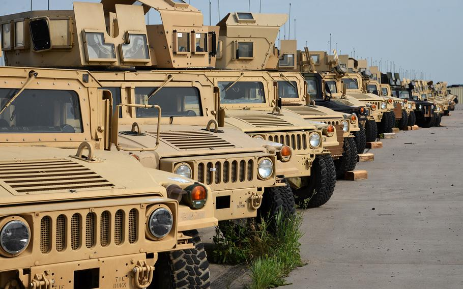 A long line of Humvees sit at Coleman Barracks in Mannheim, Germany as part of the U.S. Army's prepositioned stocks operation. The tan vehicles are being painted woodland green by the 405th Army Field Support Brigade, who oversee the operations at Coleman.