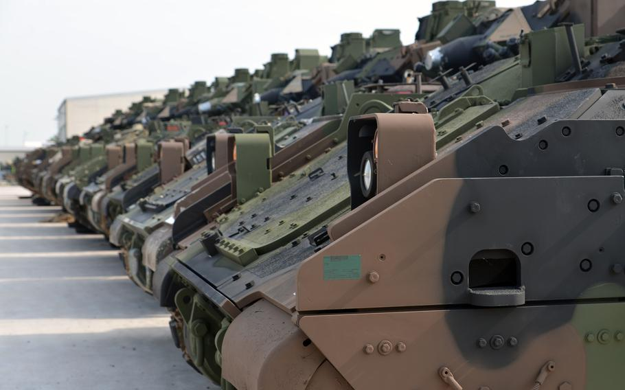 A line of Bradley Fighting Vehicles stand at Coleman Barracks in Mannheim, Germany. They are stored here as part of the U.S. Army's prepositioned stocks operation.