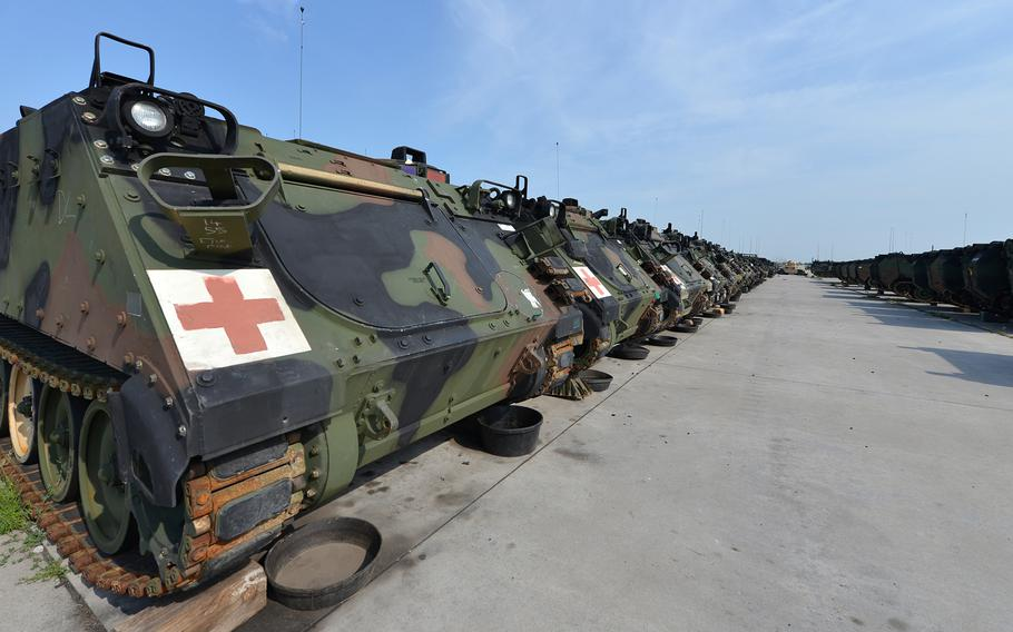 M-113 armored ambulances sit in a long line at Coleman Barracks in Mannheim, Germany.