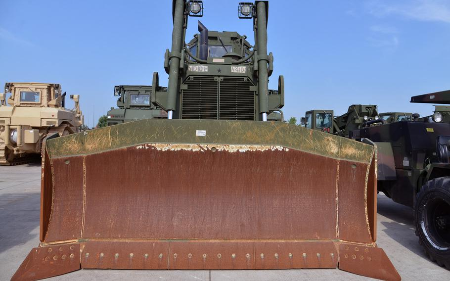 U.S. Army bulldozers are among the thousands of pieces of military equipment stored at Coleman Barracks in Mannheim, Germany. Ranging from power generators to M1 tanks, the equipment is part of the Army prepositioned stocks operation under the 405 Army Field Support Brigade.