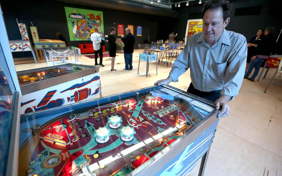 """Pacific Pinball Museum Executive Director Michael Schiess demonstrates one of the museum's pinball machines that is part of """"The Art and Science of Pinball"""" exhibit at the Chabot Space & Science Center during an advanced preview for the news media in Oakland, Calif."""