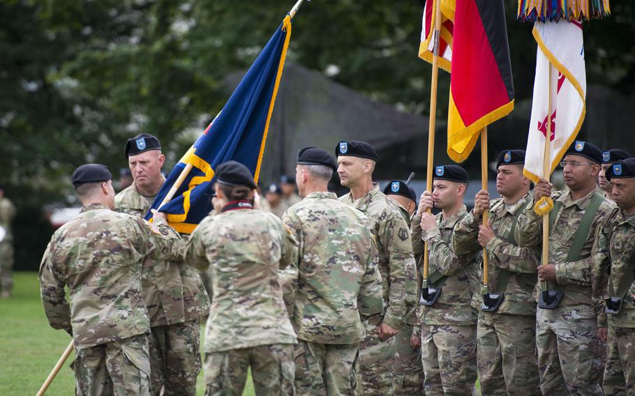 Maj. Gen. Steven Shapiro, 21st Theater Sustainment Command commander, left, passes the 7th Mission Support Command's colors to Brig. Gen. Frederick R. Maiocco Jr. during the MSC's change-of-command ceremony at Daenner Kaserne, Germany, on Friday, Aug. 4, 2017.