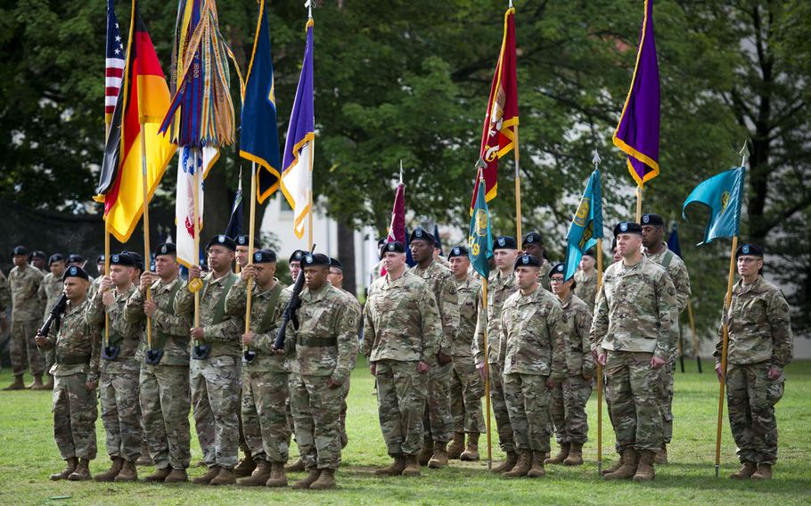 National and Army flags and colors of various units of the 7th Mission Support Command are displayed in formation during the MSC's change-of-command ceremony at Daenner Kaserne, Germany, on Friday, Aug. 4, 2017.