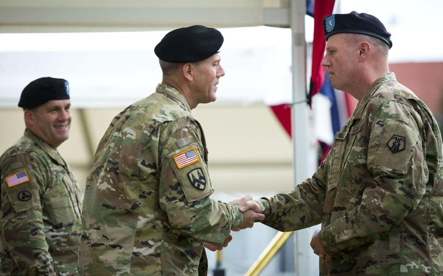 Brig. Gen. Frederick R. Maiocco Jr., right, incoming 7th Mission Support Command commander, shakes hands with Brig. Gen. Steven Ainsworth during the MSC's change-of-command ceremony at Daenner Kaserne, Germany, on Friday, Aug. 4, 2017. Ainsworth is the outgoing MSC commander.