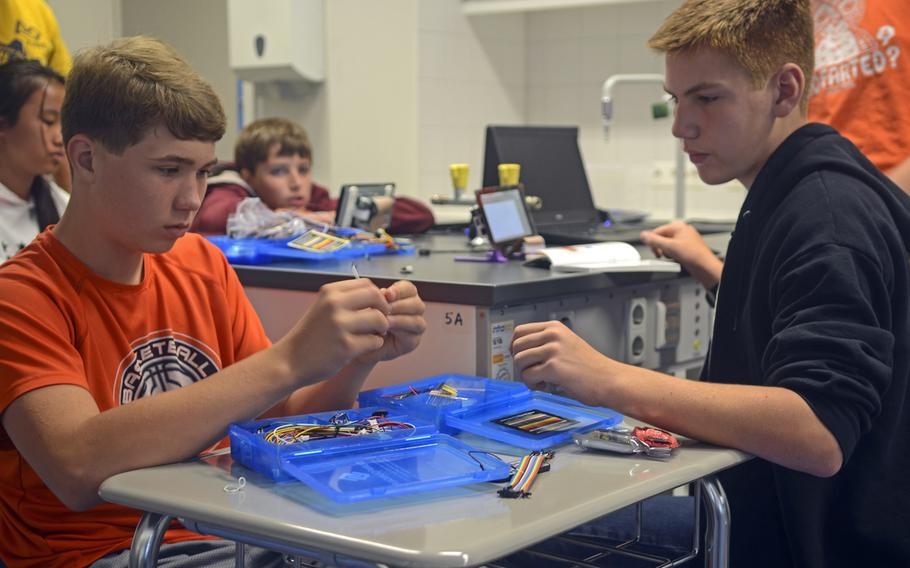 Blake Graham, left, and Paydan Swint, gather materials for a Raspberry Pi learning computer as part of a weeklong summer day camp for rising middle and high schoolers interested in computer programming, Thursday, Aug. 10, 2017 at Wiesbaden High School in Wiesbaden, Germany.