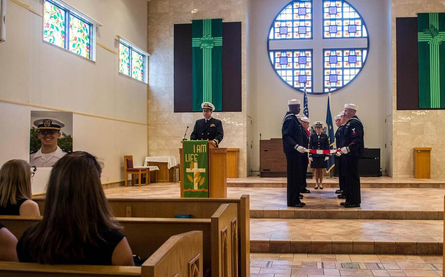 Sailors fold a flag during a memorial service for Lt. Stephen Hopkins inside the Chapel of Hope at Yokosuka Naval Base, Japan, Tuesday, Aug. 22, 2017. Hopkins, assigned to USS Stethem, was reported missing and assumed overboard on Aug. 1, 2017.