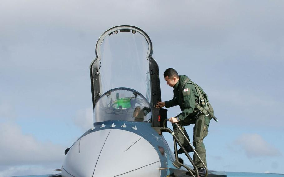 A Japan Air Self-Defense Force pilot climbs into the cockpit of a JASDF F-2 during Cope North drills last year.