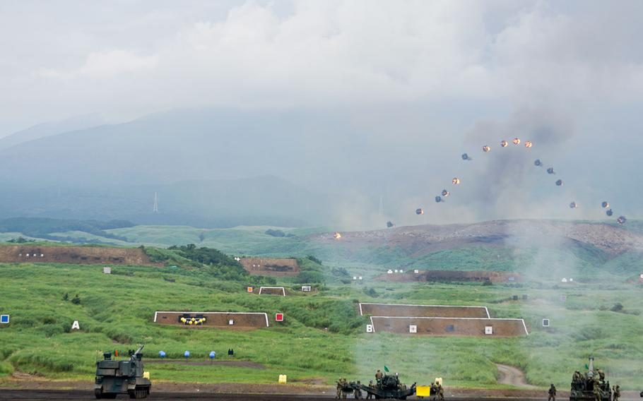 Japan Ground Self-Defense Force troops fire shells with airburst submunitions during the annual Fuji Firepower demonstration near Mount Fuji, Japan, Thursday, Aug. 24, 2017.