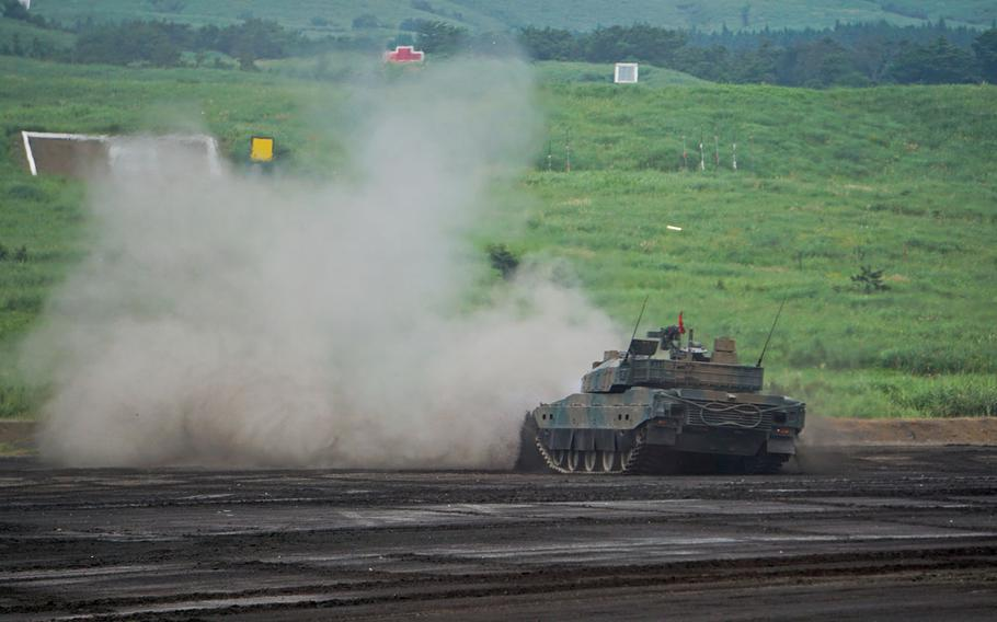 A Japanese Type 10 main battle tank, one of the most advanced armored fighting vehicles in the world, fires its 120mm cannon during the annual Fuji Firepower demonstrations near Mount Fuji, Japan, Thursday, Aug. 24, 2017.
