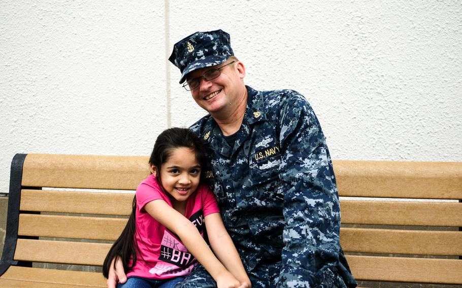 Senior Chief Larry Rigdon poses with his daughter, Julianne, a first-grader at Sullivans Elementary School at Yokosuka Naval Base, Japan, Monday, Aug. 28, 2017.