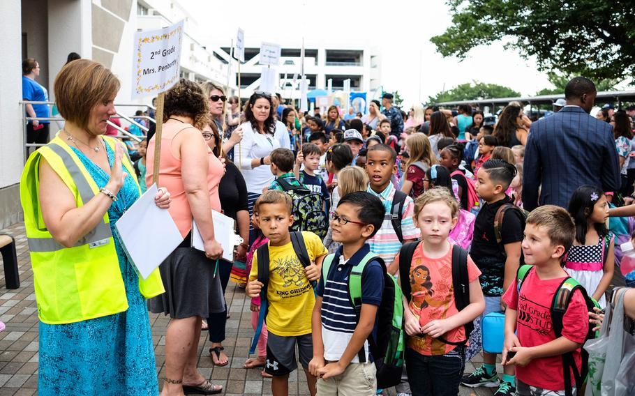 Students wait with their teacher to begin the first day of school at Sullivans Elementary at Yokosuka Naval Base, Japan, Monday, Aug. 28, 2017.