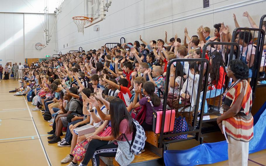 Sixth-graders raise their hands during the first day of class at Yokota Middle School at Yokota Air Base, Japan, Monday, August 28, 2017.