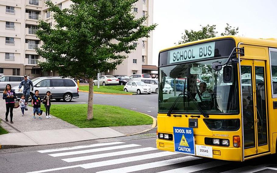 A bus brings students to their first day of classes at Yokosuka Naval Base, Japan, Monday, Aug. 28, 2017.