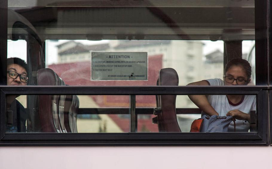 Students board buses home after their first day of classes at Camp Humphreys High School, South Korea, Monday, Aug. 28, 2017.