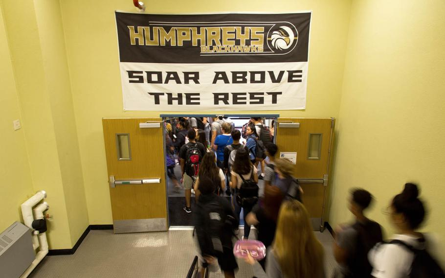 Students rush for the doors at the end of their first day of classes at Camp Humphreys High School, Monday, Aug. 28, 2017.