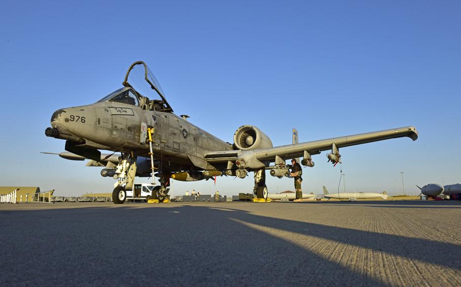 A pilot conducts a preflight check on an A-10 Thunderbolt II on July 11, 2017, at Incirlik Air Base, Turkey. The A-10s support ground forces with rapid employment close air and contact support. It utilizes a variety of bomb, missiles and a 30mm GAU-8 seven-barrel Gatling gun.