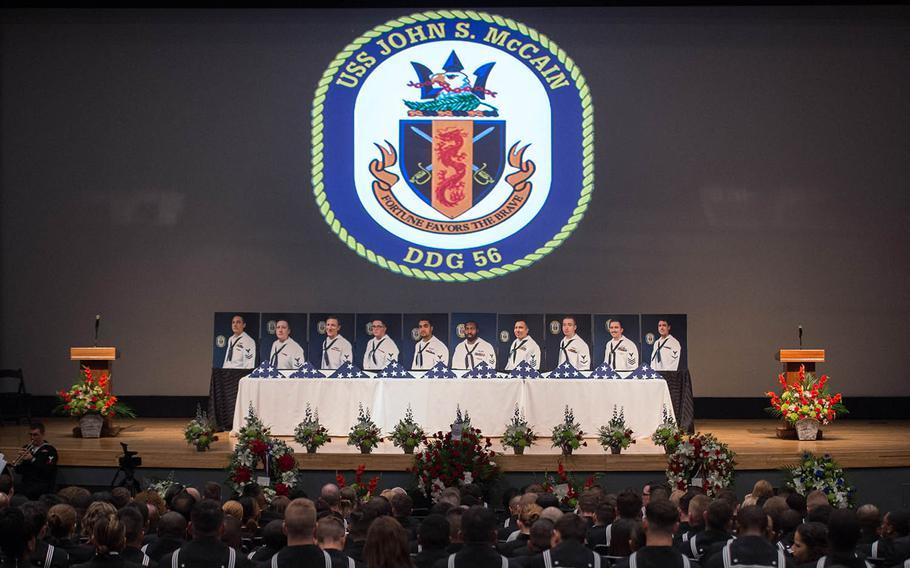 Sailors from the USS John S. McCain attend a memorial service at Yokosuka Naval Base, Japan, Wednesday, Oct. 4., 2017.
