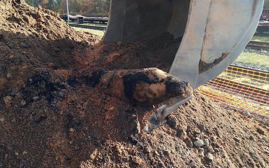 A WWII-era, unexploded bomb is revealed at a construction site for a new school near the U.S. Army's Grafenwoehr Training Area on Wednesday. German authorities defused the bomb and U.S. soldiers later detonated the 1,000-pound bomb.