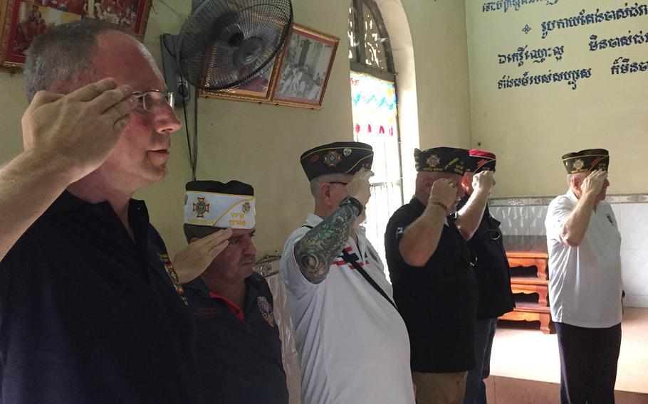 Veterans of Foreign Wars members render a final salute for deceased Air Force veteran Jimmie Herschal Sillavan at Wat Ounalom in Phnom Penh, Cambodia, Sunday, Nov. 19, 2017.