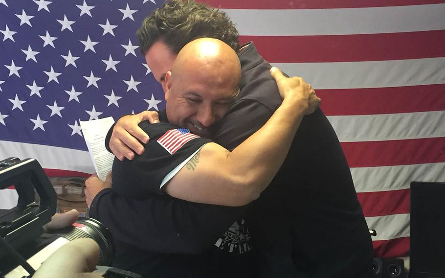 Deported Army veteran, Hector Barajas-Varela, hugs former state Assemblyman and Marine Nathan Fletcher on April 15 at the shelter for deported veterans  in Tijuana, Mexico, after learning that he'd been pardoned by the California governor.