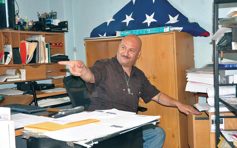 Deported veteran Hector Barajas, is busy at his desk at the shelter he founded in Tijuana, Mexico on June 1, 2016. Barajas is being considered for naturalization after seven years of deportation.
