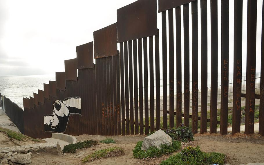 The fence demarcating the border between Tijuana, Mexico and San Diego, California plunges deep into the Pacific Ocean. When families are allowed to meet on opposite sides, they reach through the tiny steel grating and link pinkies.