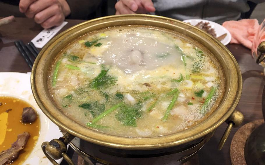 The lamb-bone soup from Tohoku Jinka in Yokohama, Japan, is a good dish for those who appreciate spicy food.