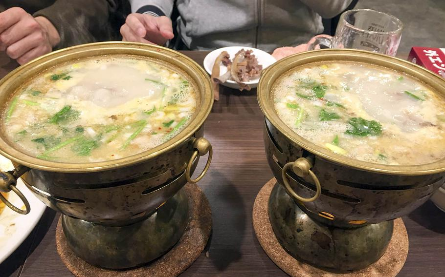 Two helpings of lamb-bone soup from Tohoku Jinka in Yokohama, Japan. This Chinatown-area eatery serves lamb in a variety of ways.