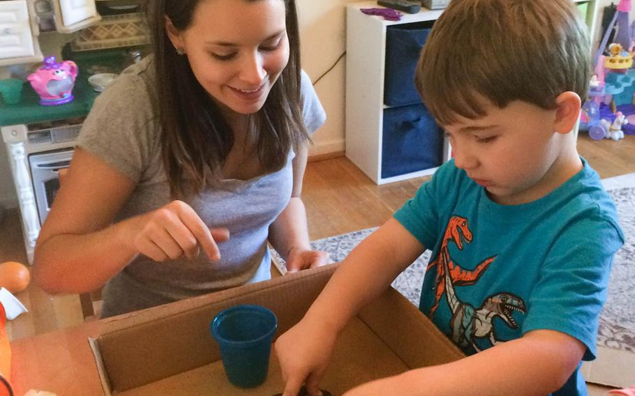"""Registered behavior technician Annalise Dzyak works with then 5-year old Evan on his life and coping skills two years ago. His mother Mandy Farmer, who writes a blog """"Motherhood"""" says her  therapy services for her son, now 7, have been cut in half due to glitches in the Tricare overhaul on Jan. 1."""
